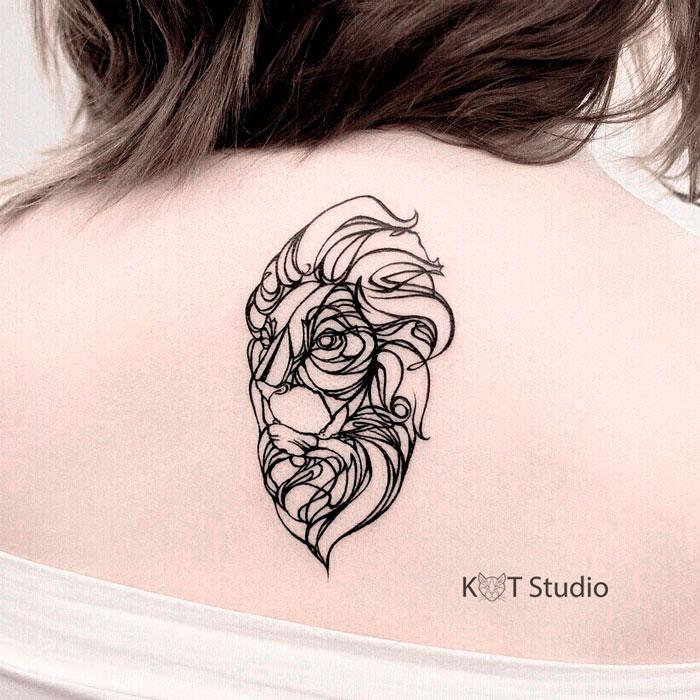 Женское тату на спине в стиле лайнворк. Татуировка с животными